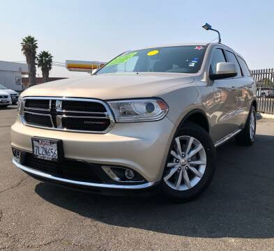 2014 Dodge Durango for sale at LUGO AUTO GROUP in Sacramento CA