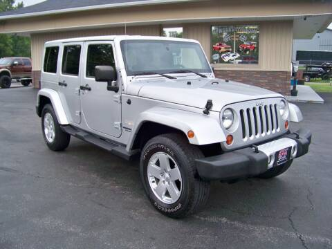 2011 Jeep Wrangler Unlimited for sale at RPM Auto Sales in Mogadore OH