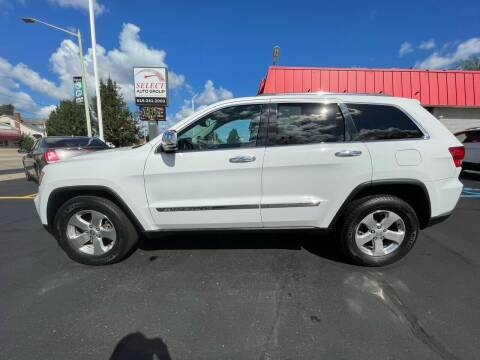 2013 Jeep Grand Cherokee for sale at Select Auto Group in Wyoming MI