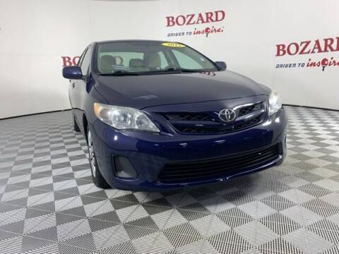 2012 Toyota Corolla for sale at BOZARD FORD in Saint Augustine FL