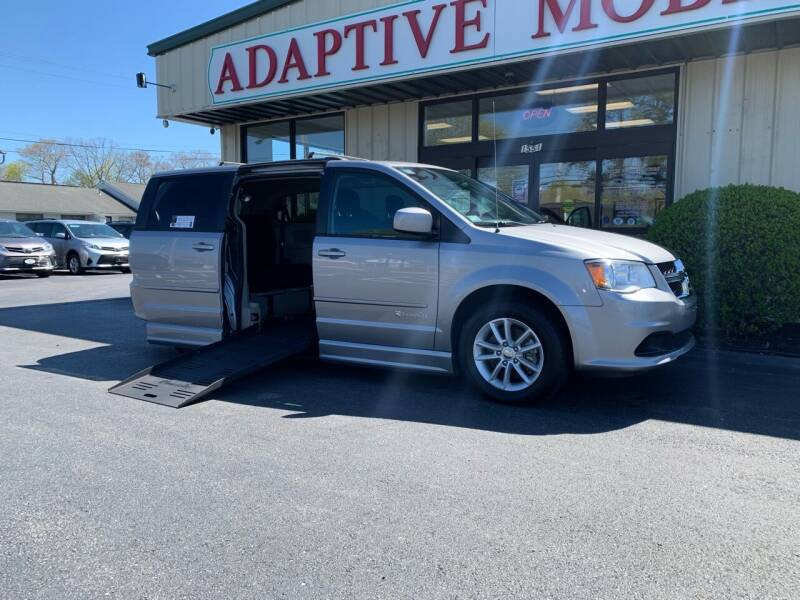2016 Dodge Grand Caravan for sale at Adaptive Mobility Wheelchair Vans in Seekonk MA