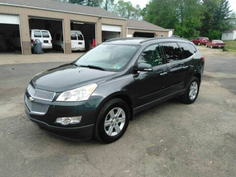 2011 Chevrolet Traverse for sale at Jim's Hometown Auto Sales LLC in Byesville OH