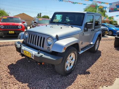 2015 Jeep Wrangler for sale at A AND A AUTO SALES in Gadsden AZ
