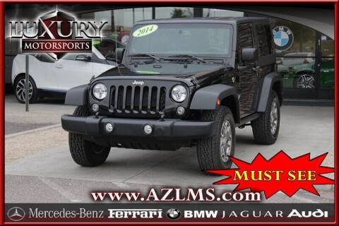 2014 Jeep Wrangler for sale at Luxury Motorsports in Phoenix AZ