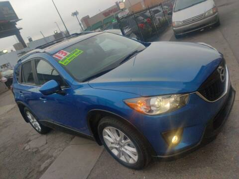 2013 Mazda CX-5 for sale at Sanaa Auto Sales LLC in Denver CO