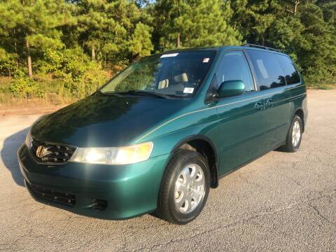 2002 Honda Odyssey for sale at WIGGLES AUTO SALES INC in Mableton GA