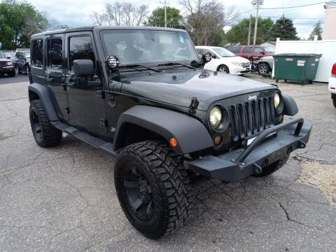 2011 Jeep Wrangler Unlimited for sale at River Motors in Portage WI