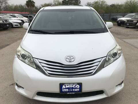 2011 Toyota Sienna for sale at AMIGO USED CARS in Houston TX
