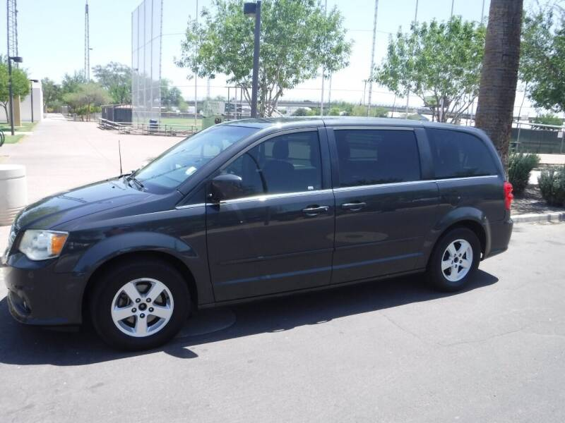 2012 Dodge Grand Caravan for sale at J & E Auto Sales in Phoenix AZ