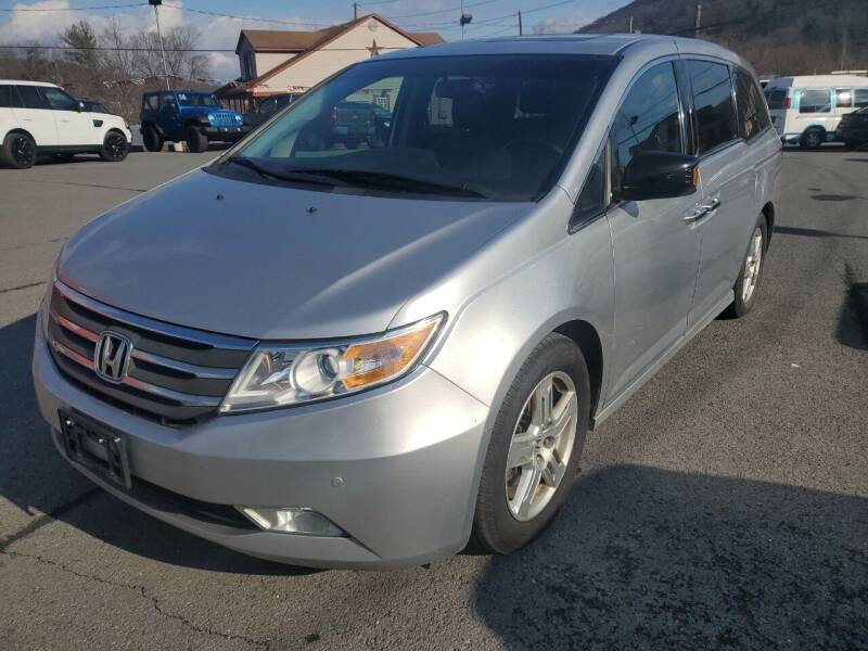 2012 Honda Odyssey for sale at Mulligan's Auto Exchange LLC in Paxinos PA