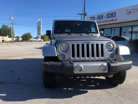 2017 Jeep Wrangler Unlimited for sale at Trust Autos, LLC in Decatur GA