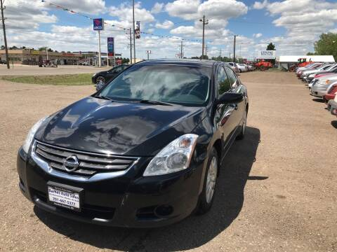 2010 Nissan Altima for sale at BARNES AUTO SALES in Mandan ND