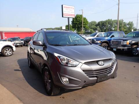 2015 Hyundai Tucson for sale at Marty's Auto Sales in Savage MN