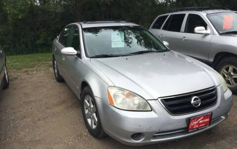 2002 Nissan Altima for sale at BARNES AUTO SALES in Mandan ND