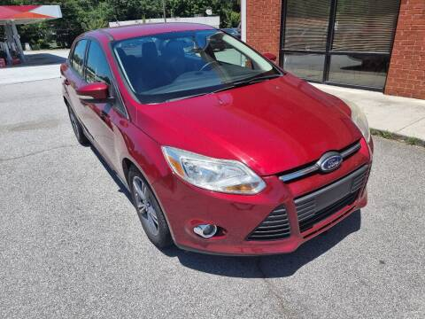 2014 Ford Focus for sale at Credit Cars LLC in Lawrenceville GA