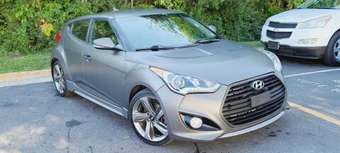 2014 Hyundai Veloster for sale at BOOST MOTORS LLC in Sterling VA