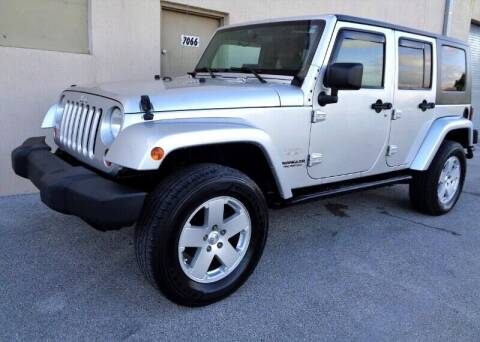 2010 Jeep Wrangler Unlimited for sale at Selective Motor Cars in Miami FL