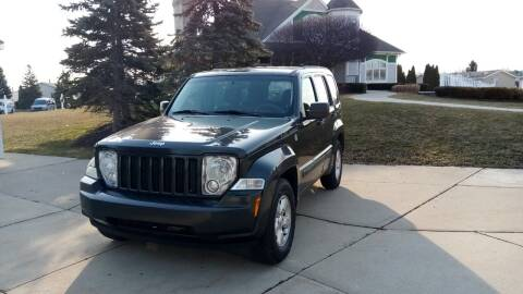 2011 Jeep Liberty for sale at Heartbeat Used Cars & Trucks in Harrison Twp MI