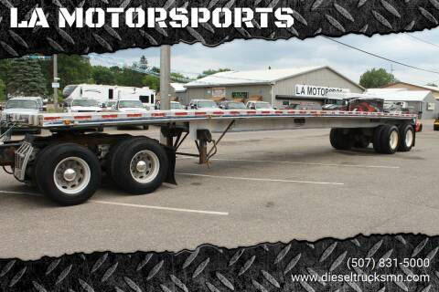 1987 EAST FLATBED for sale at LA MOTORSPORTS in Windom MN