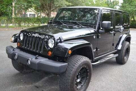 2012 Jeep Wrangler Unlimited for sale at ManyEcars.com in Mount Dora FL