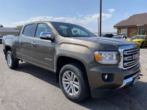 2015 GMC Canyon for sale at BERKENKOTTER MOTORS in Brighton CO