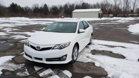 2014 Toyota Camry for sale at Caruzin Motors in Flint MI