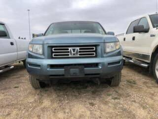 2006 Honda Ridgeline for sale at BERG AUTO MALL & TRUCKING INC in Beresford SD