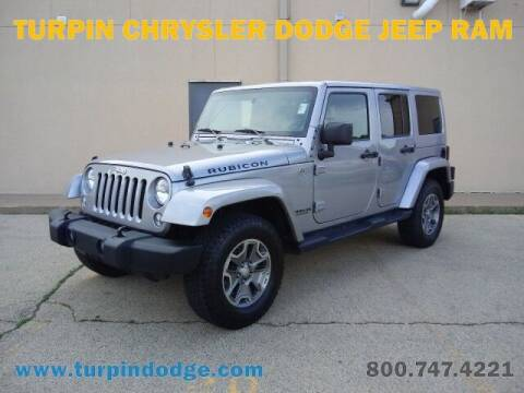 2015 Jeep Wrangler Unlimited for sale at Turpin Dodge Chrysler Jeep Ram in Dubuque IA