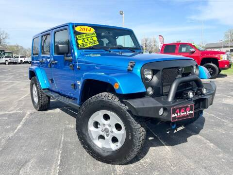 2014 Jeep Wrangler Unlimited for sale at A & S Auto and Truck Sales in Platte City MO