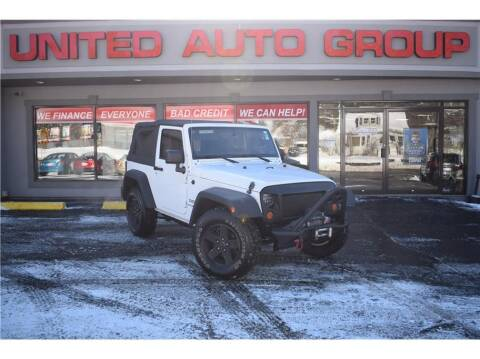 2013 Jeep Wrangler for sale at United Auto Group in Putnam CT