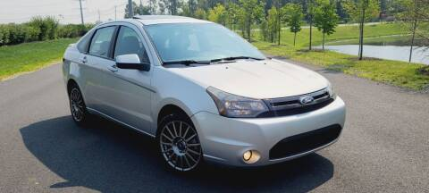 2010 Ford Focus for sale at BOOST MOTORS LLC in Sterling VA