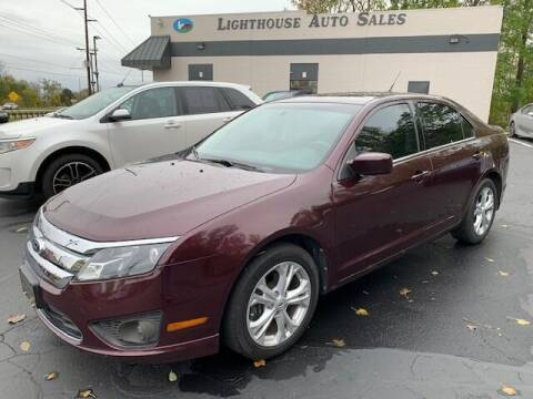 2012 Ford Fusion for sale at Lighthouse Auto Sales in Holland MI