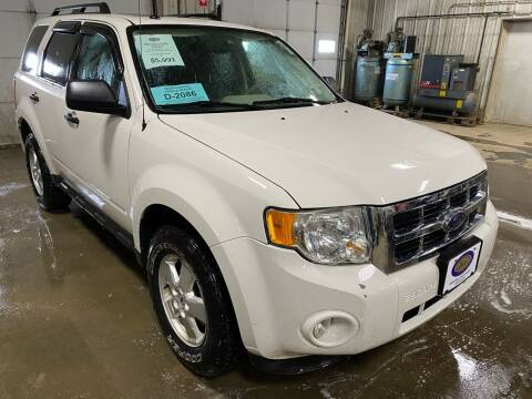 2009 Ford Escape for sale at BERG AUTO MALL & TRUCKING INC in Beresford SD