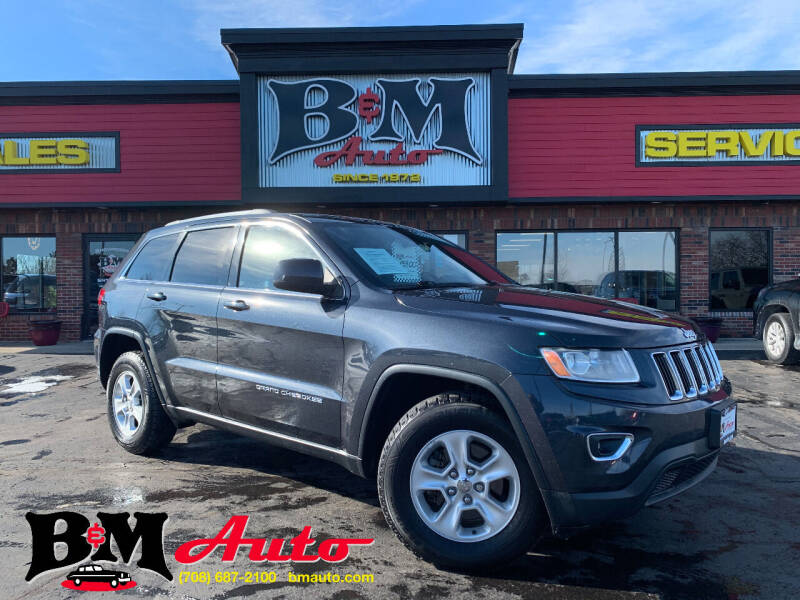 2014 Jeep Grand Cherokee for sale at B & M Auto Sales Inc. in Oak Forest IL