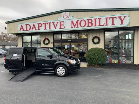 2014 Dodge Grand Caravan for sale at Adaptive Mobility Wheelchair Vans in Seekonk MA