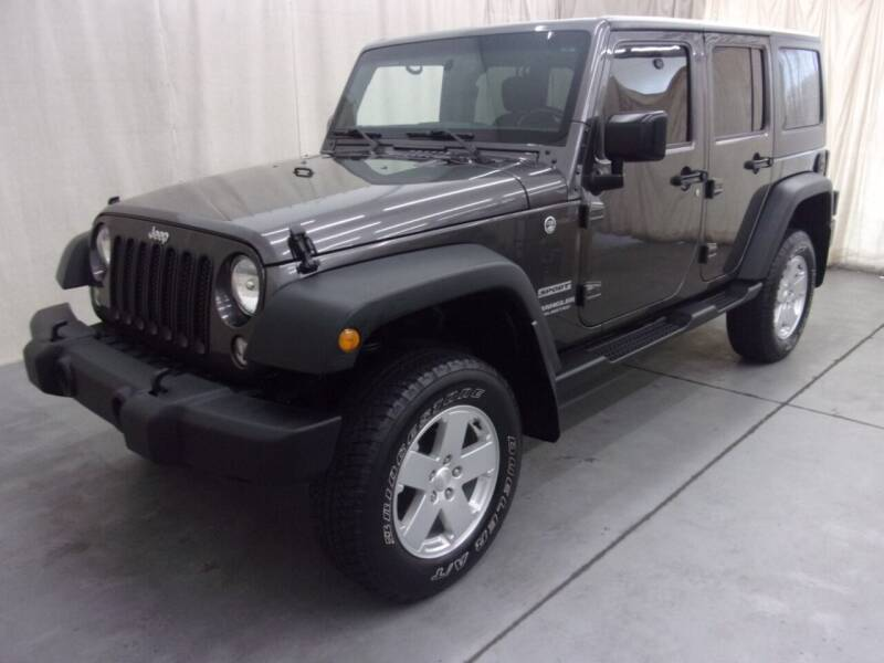 2016 Jeep Wrangler Unlimited for sale at Paquet Auto Sales in Madison OH