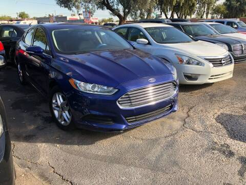 2014 Ford Fusion for sale at Valley Auto Center in Phoenix AZ