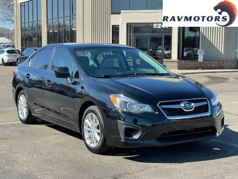 2014 Subaru Impreza for sale at RAVMOTORS 2 in Crystal MN