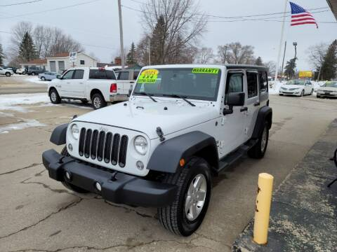 2015 Jeep Wrangler Unlimited for sale at Clare Auto Sales, Inc. in Clare MI
