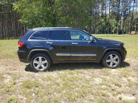2012 Jeep Grand Cherokee for sale at McLain's Auto Sales in Lake City MI