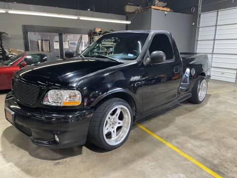 2000 Ford F-150 SVT Lightning for sale at EA Motorgroup in Austin TX