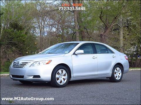2009 Toyota Camry for sale at M2 Auto Group Llc. EAST BRUNSWICK in East Brunswick NJ