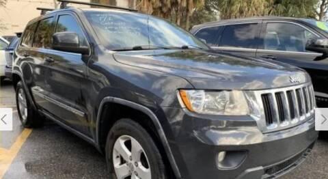 2011 Jeep Grand Cherokee for sale at EZ Own Car Sales of Miami in Miami FL
