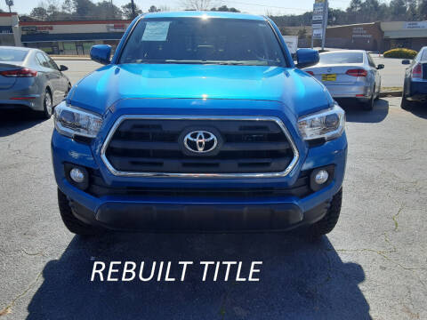2017 Toyota Tacoma for sale at LOS PAISANOS AUTO & TRUCK SALES LLC in Peachtree Corners GA