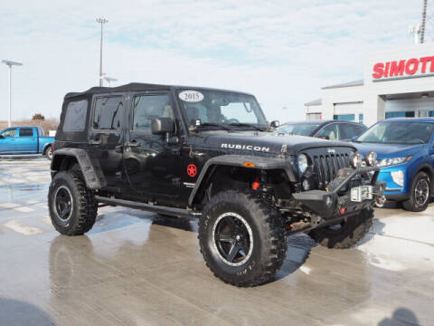 2015 Jeep Wrangler Unlimited for sale at SIMOTES MOTORS in Minooka IL