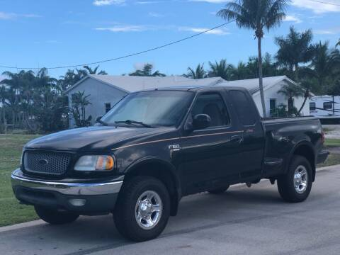 1999 Ford F-150 for sale at L G AUTO SALES in Boynton Beach FL