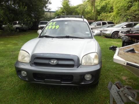 2005 Hyundai Santa Fe for sale at SCOTT HARRISON MOTOR CO in Houston TX