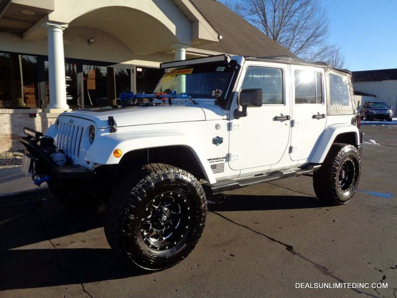 2012 Jeep Wrangler Unlimited for sale at DEALS UNLIMITED INC in Portage MI
