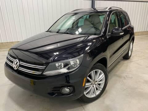 2013 Volkswagen Tiguan for sale at EUROPEAN AUTOHAUS, LLC in Holland MI