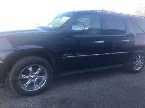 2009 Chevrolet Suburban for sale at BARNES AUTO SALES in Mandan ND
